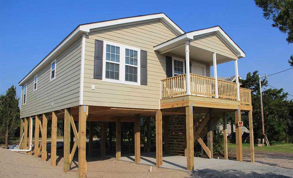 Need a narrow lot modular down east homes of morehead city for Lot one homes