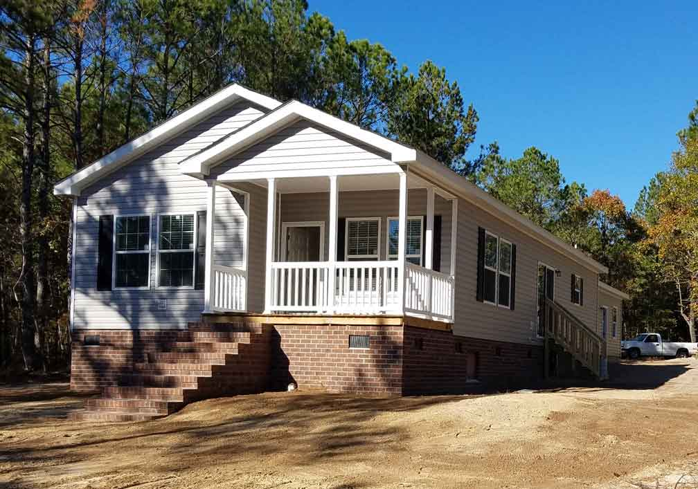 Need a narrow lot modular down east homes of morehead city for Narrow lot prefab homes